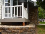 TemberTech XLM deck with white RadianceRail & Pavestone retaining wall